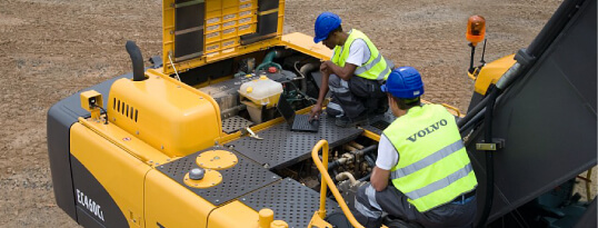 Picture of workers servicing equipment